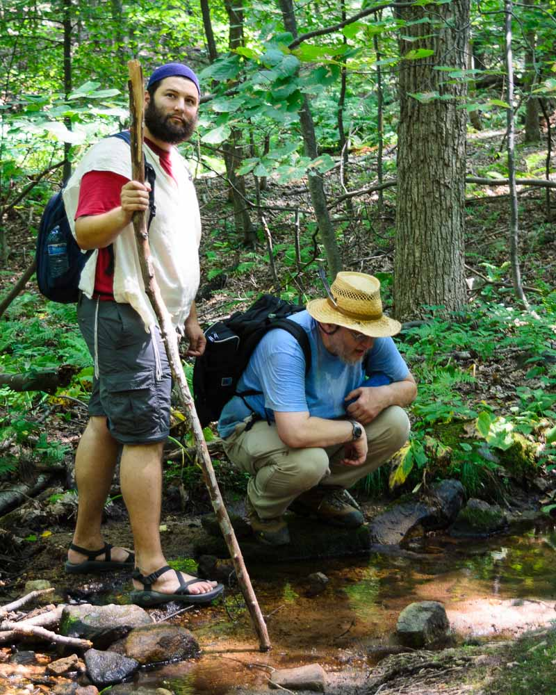A friend and I examining a glistening stream by the side of the Blue Trail